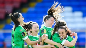 Lucy McCartan, second from right, celebrates with Peamount United team-mates after scoring her side's first goal