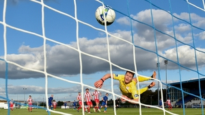 Sligo Rovers goalkeeper Ed McGinty watches as a shot from Waterford's Matthew Smith hits the back of the net