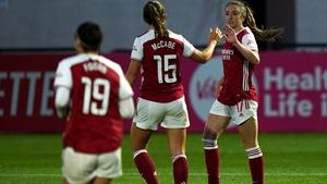 Katie McCabe (15) congratulates Arsenal's Lisa Evans on her hat-trick