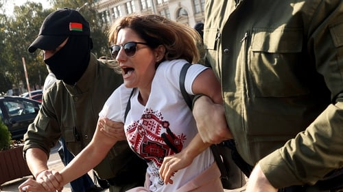 A woman is detained during the protest in Minsk, Belarus yesterday
