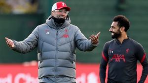 Jurgen Klopp (L) and Mo Salah, seemingly not discussing Liverpool's unbeaten record at Anfield