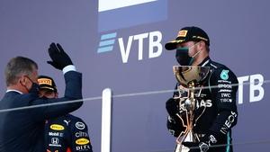Valtteri Bottas celebrates with the trophy