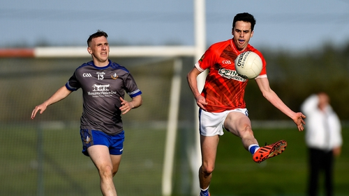 Karl Faulkner of Ardee St Mary's in action against Conor Whelan of Naomh Mairtin