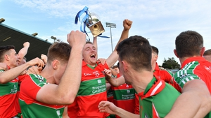 Ballymun Kickhams players celebrate after their commanding win