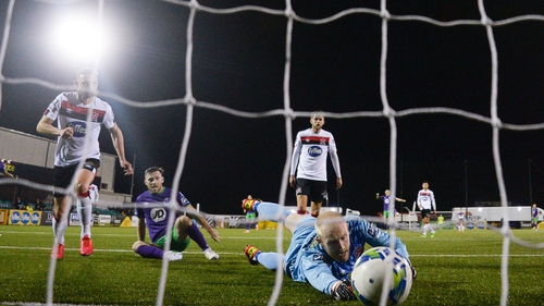 Jack Byrne squeezes home the opener for Shamrock Rovers