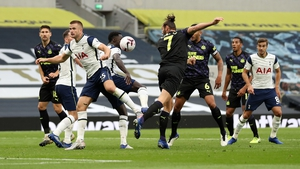 Newcastle won a penalty after Andy Carroll headed the ball at Eric Dier's arm