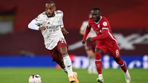 Alexandre Lacazette of Arsenal battles for possession with Naby Keita