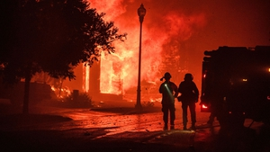A home bursts into flames from the Shady Fire as it approaches Santa Rosa, California