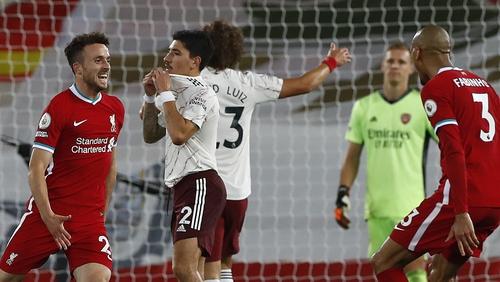 Diogo Jota (L) celebrates his goal with Fabinho