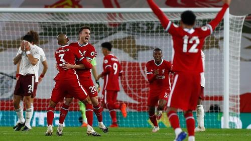 Liverpool's Portuguese striker Diogo Jota (3L) celebrates