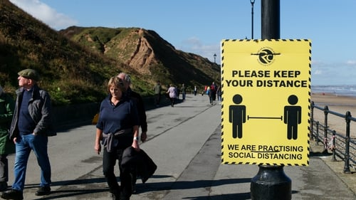 Walkers on the promenade at Saltburn-by-the-Sea in Yorkshire