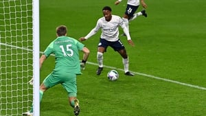 Raheem Sterling scores his side's second goal