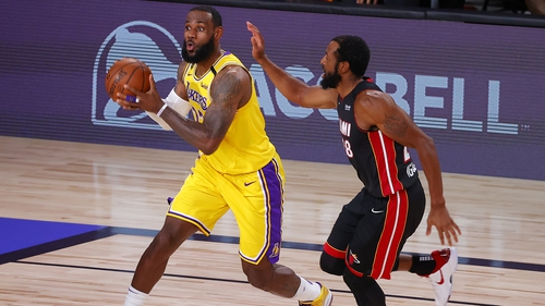 LeBron James, left, drives past Andre Iguodala of the Miami Heat