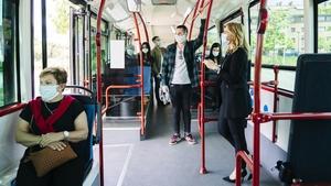 People wearing masks on a public bus in Spain