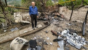 A man is surrounded by debris from an Azeri drone shelling that killed his wife in Hadrut, Nagorno-Karabakh