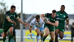 Peter Sullivan of Connacht makes a break with Bundee Aki in support