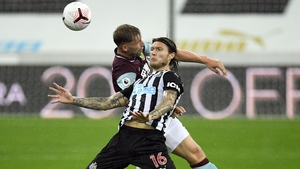 Newcastle and Ireland's Jeff Hendrick battles for the ball with Charlie Taylor