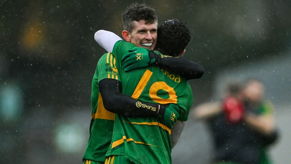 Rhode players Stephen Hannon, left, and Paul McPadden celebrate at the final whistle