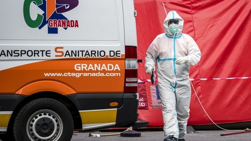 A paramedic is seen near his vehicle at the Virgen de las Nieves hospital in Granada, Spain