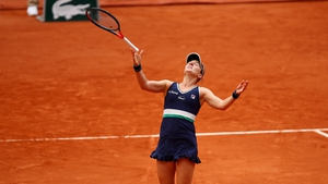 An elated Nadia Podoroska celebrates a victory she will never forget at Roland Garros