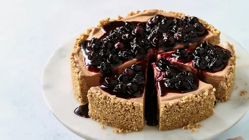 Nadiya's banana ice cream cheesecake recipe with blueberry compote