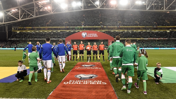 Ireland and Bosnia and Herzegovina walk out onto the pitch before the start of their Euro 2016 play-off at the Aviva