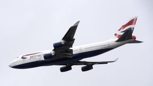 A British Airways Boeing 747 aircraft makes a flypast over London Heathrow airport on its final flight today