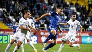 Bosnia and Herzegovina's Edin Dzeko (centre) battles for the ball with Northern Ireland's Jonny Evans