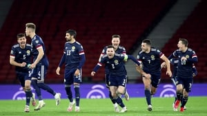 The Scottish players show their delight at advancing