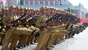 Servicemen march during a military parade marking the 70th anniversary of the foundation of North Korea in 2018