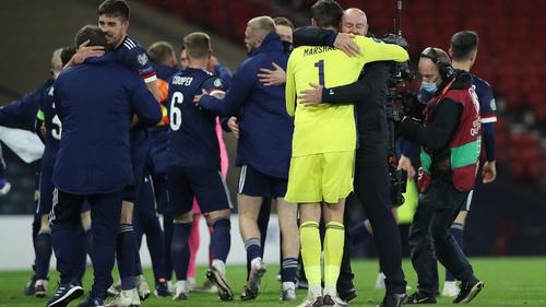 David Marshall and Steve Clarke embrace after Scotland's shootout heroics