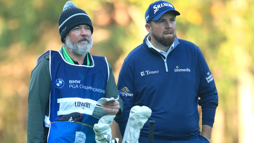 Lowry and his caddy Brian 'Bo' Martin (L) during his second round at Wentworth