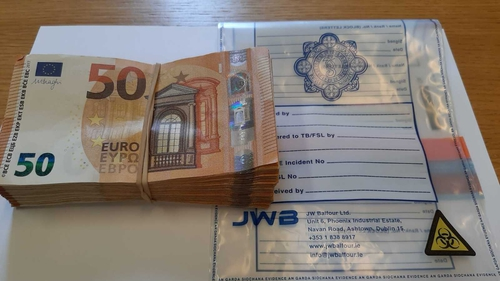 Cash was seized during the search of a house