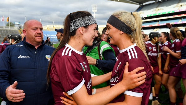 Helebert, right, celebrates the All-Ireland victory over Kilkenny with Anne-Marie Starr