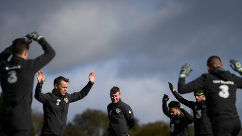 Ireland players go through their warm-up in Abbotstown