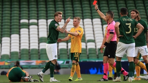 James McClean takes issue with the decision of Anastasios Sidiropoulos to give him his marching orders