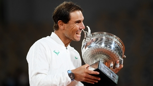 Rafael Nadal taking a bite of the Coupe des Mousquetaires has become an iconic image in sport