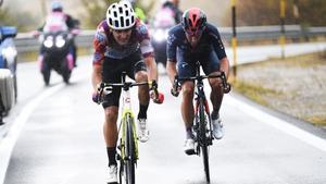 Ruben Guerreiro pedals through the rain on stage nine