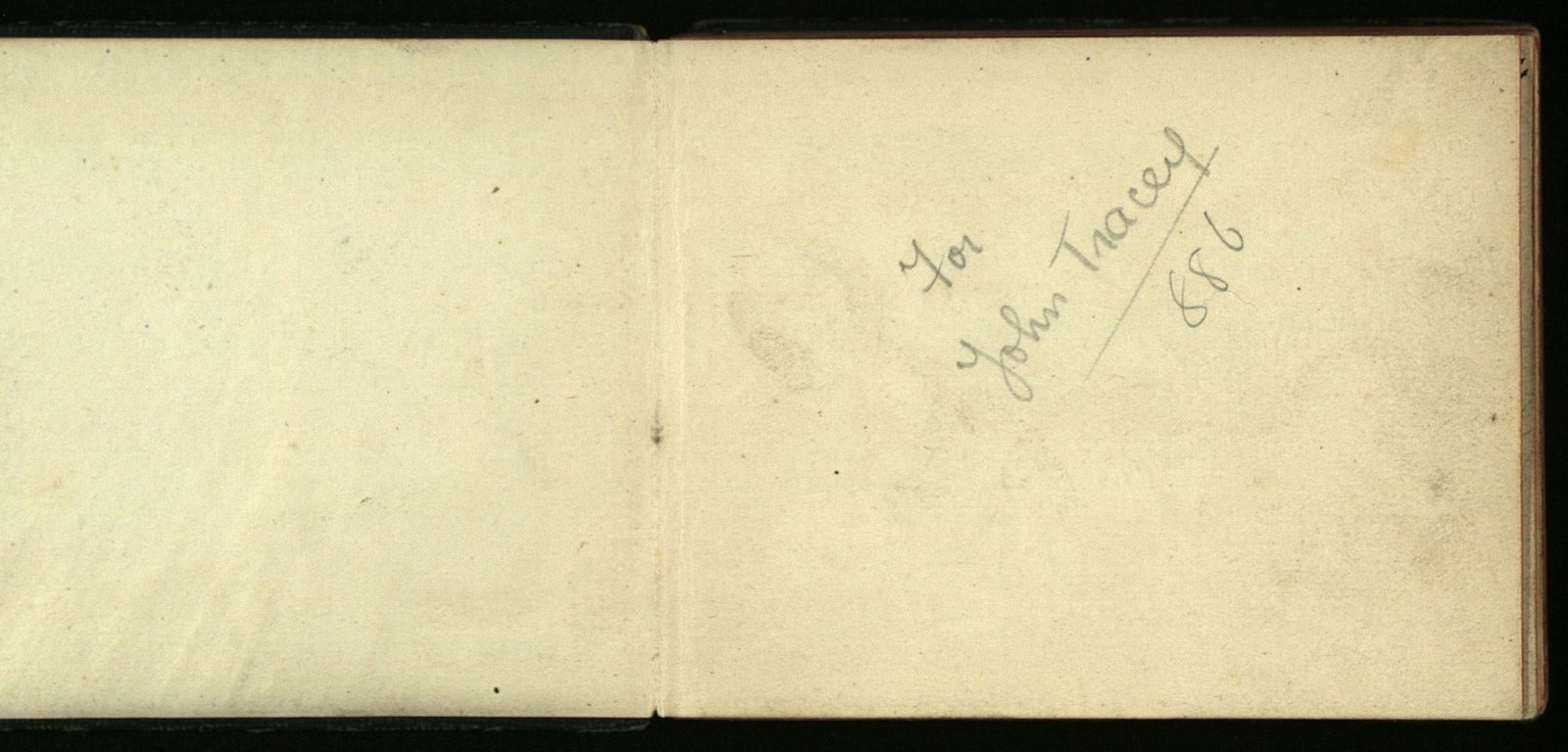 Image - The cover and inside dedication page of the autograph book