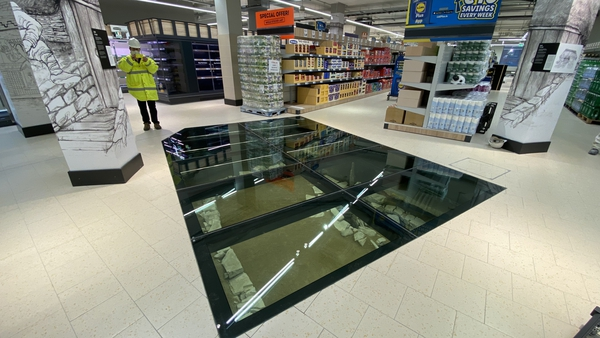 The remains of an 11th century house are displayed beneath a glass section of the floor of the new Lidl store in Dublin city centre