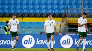 Jack Taylor, Conor Coventry and Conor Masterson react after Italy's second goal