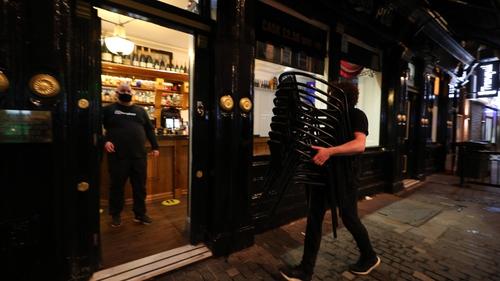 Staff at the Richmond Pub in Liverpool prepare for Tier 3 shutdown