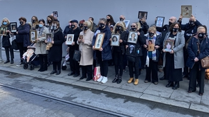 Families of the Stardust victims gather outside the Coroner's Court