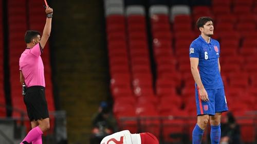 Harry Maguire is dismissed for a tackle on Denmark's striker Kasper Dolberg