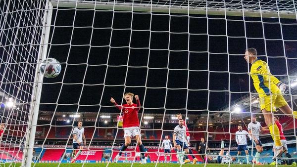 Erling Braut Haaland celebrates after Northern Ireland's Stuart Dallas puts the ball past Trevor Carson
