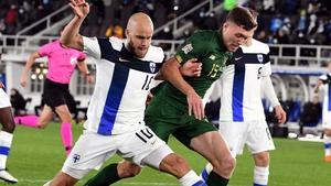 Dara O'Shea battles with Finland striker Teemu Pukki during the game in Helsinki