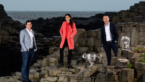 Seán Cavanagh, Joanne Cantwell and Oisín McConville with the Sam Maguire and Liam MacCarthy