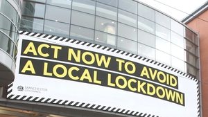 A sign on Market Street in Manchester, one of the areas facing stricter restrictions