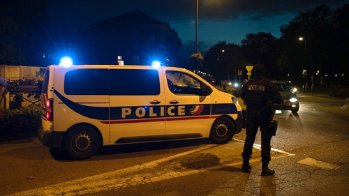French police officers stand guard near the scene of the stabbing in Paris