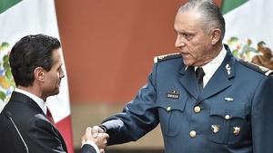 General Cienfuegos (R) pictured with former Mexican president Enrique Pena Nieto in 2016